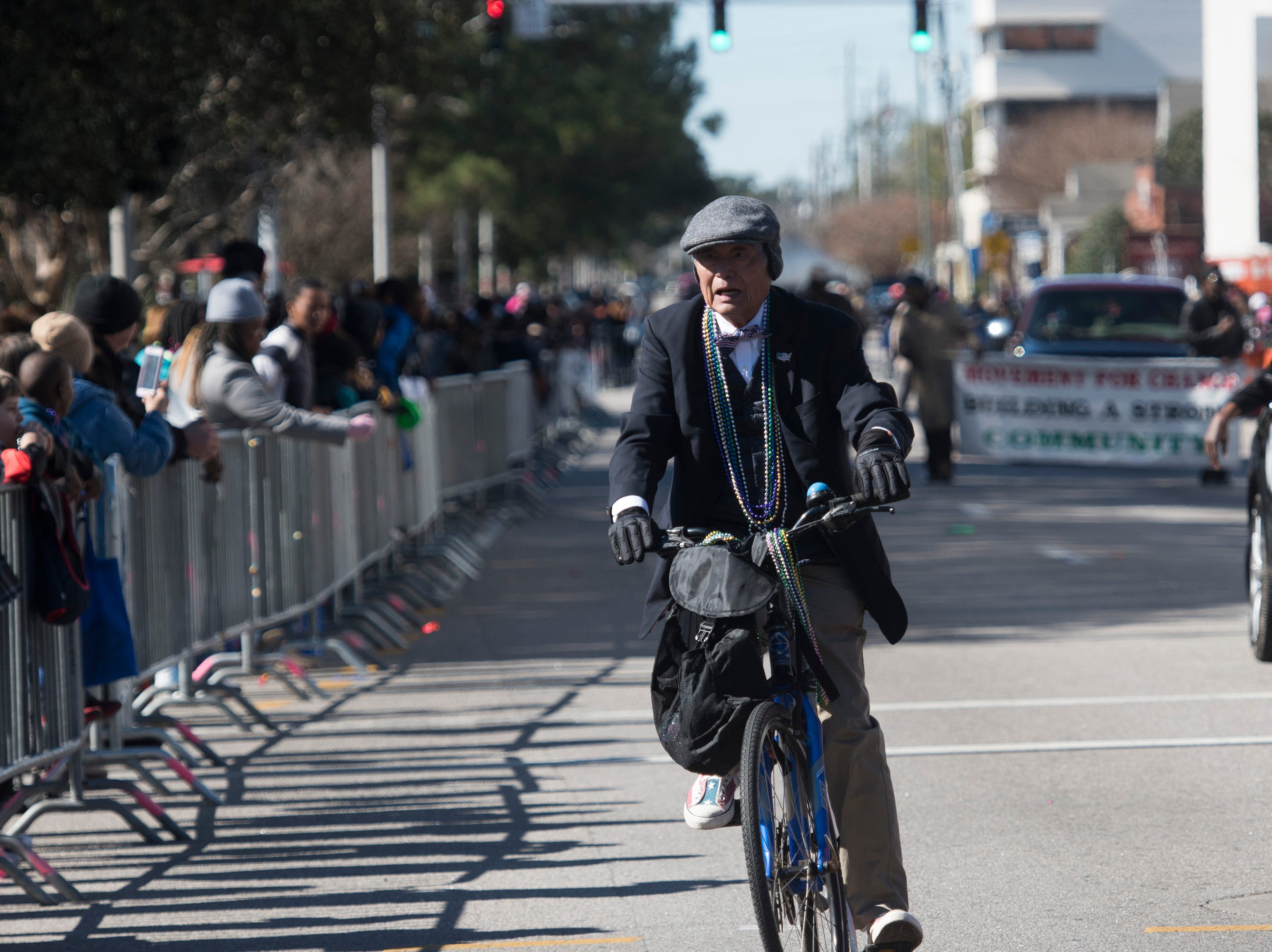 Pensacola City Councilman, P.C. WU hits the Martin Luther King, Jr. parade route on a bike on Monday, Jan. 21, 2019.