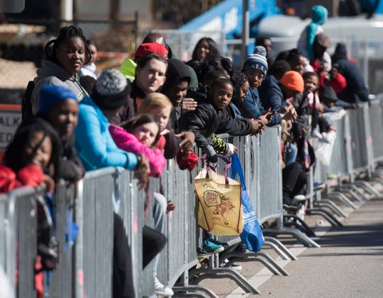 People participate in the 2019 Dr. Martin Luther King Jr. Day Parade in downtown Pensacola.