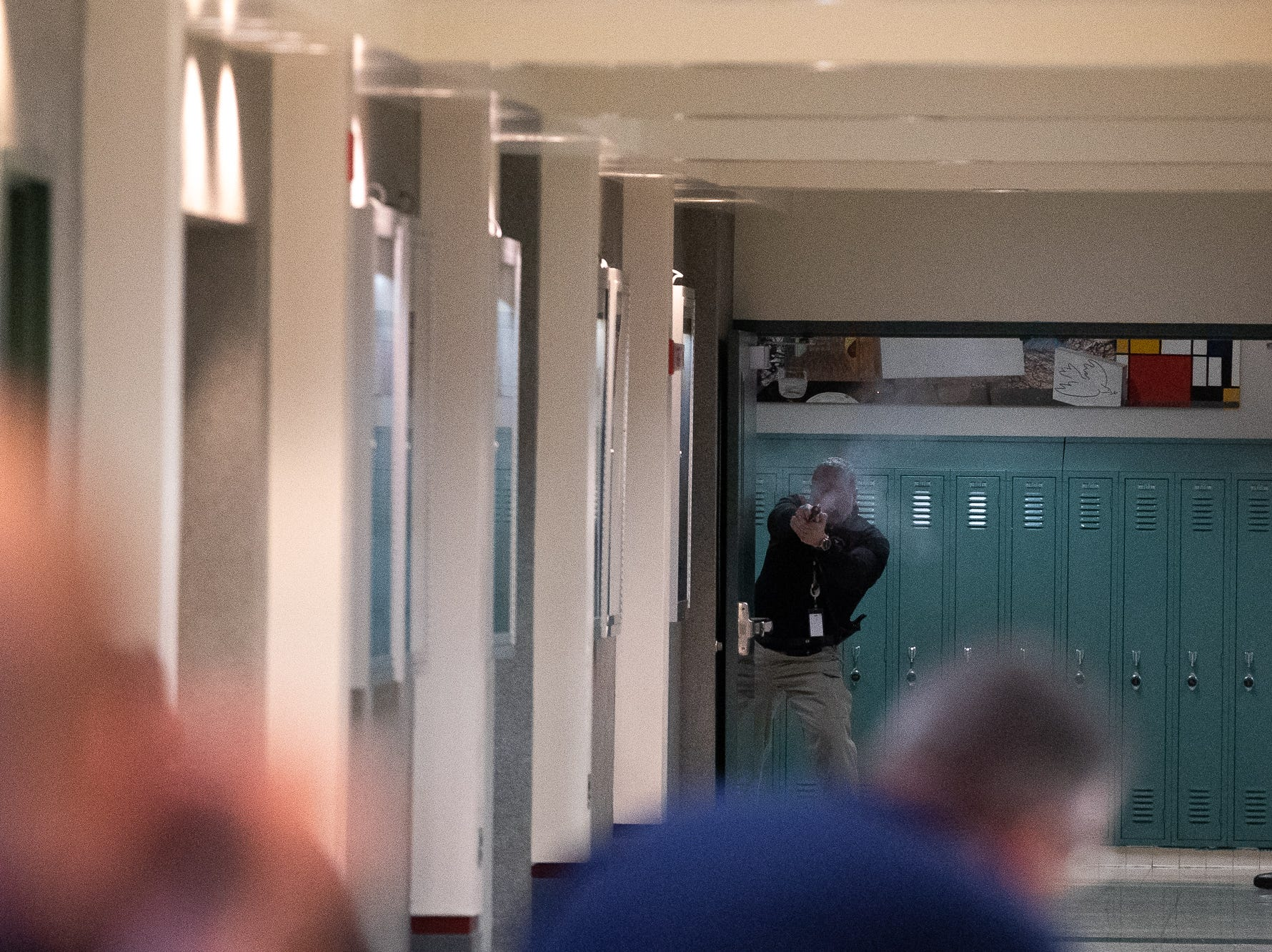 A school security guard opens fire and takes down a man portraying an active shooter during an active shooter drill at South Western High School, Monday, Jan. 21, 2019, in Penn Township. The drill simulated multiple scenarios involving an active shooter, allowing school security and local law enforcement agencies a hands-on opportunity to drill on engaging an active shooter while also giving school staff experience with how real world scenarios could unfold.