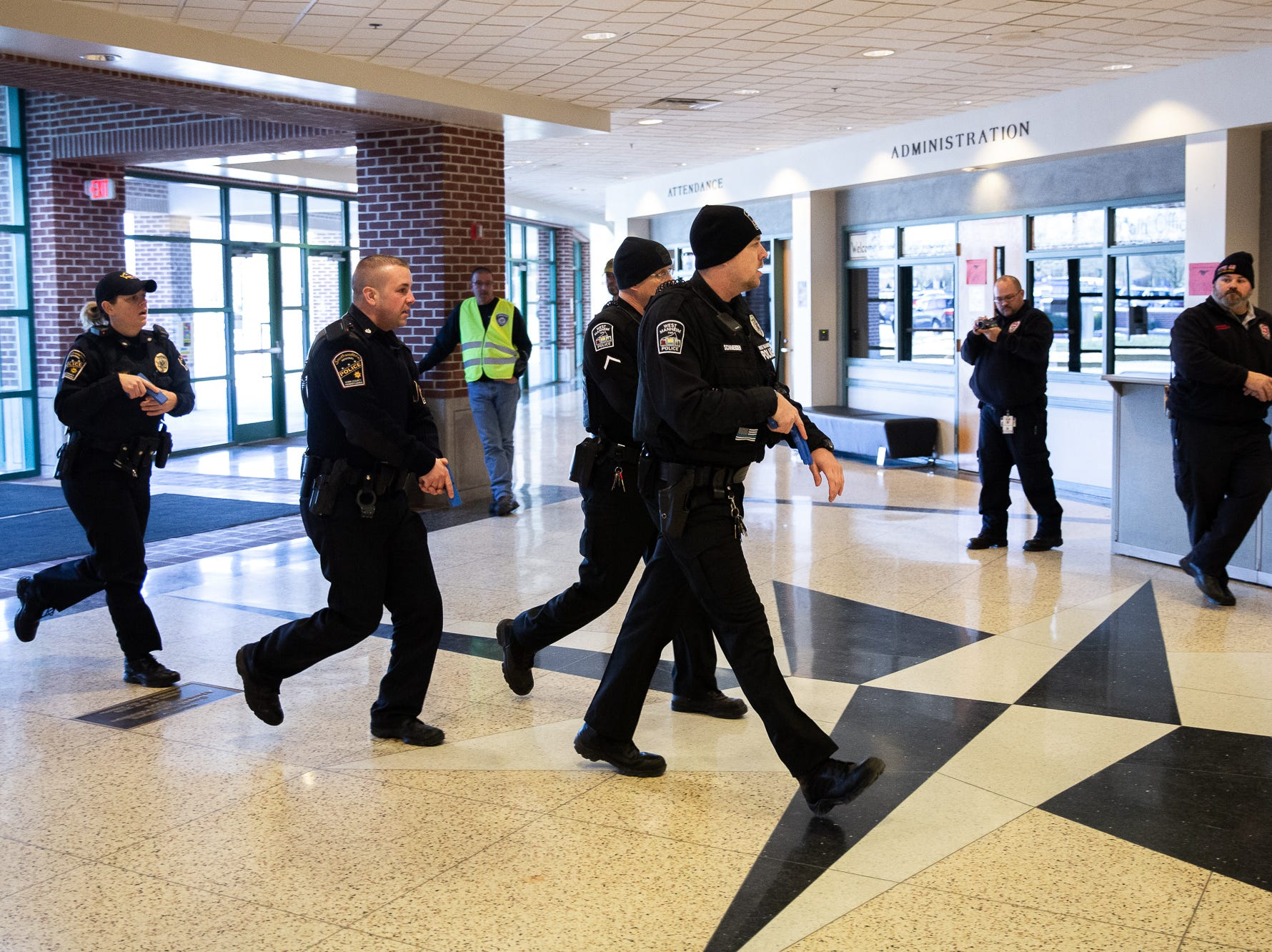 Police officers take part in an active shooter drill at South Western High School, Monday, Jan. 21, 2019, in Penn Township. The drill simulated multiple scenarios involving an active shooter, allowing school security and local law enforcement agencies a hands-on opportunity to drill on engaging an active shooter while also giving school staff experience with how real world scenarios could unfold.