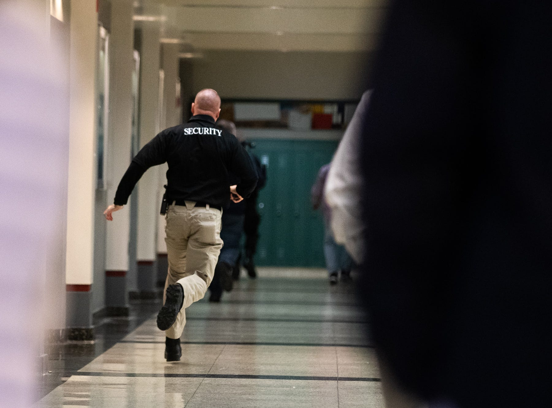 A school security guard takes part in an active shooter drill at South Western High School, Monday, Jan. 21, 2019, in Penn Township. The drill simulated multiple scenarios involving an active shooter, allowing school security and local law enforcement agencies a hands-on opportunity to drill on engaging an active shooter while also giving school staff experience with how real world scenarios could unfold.
