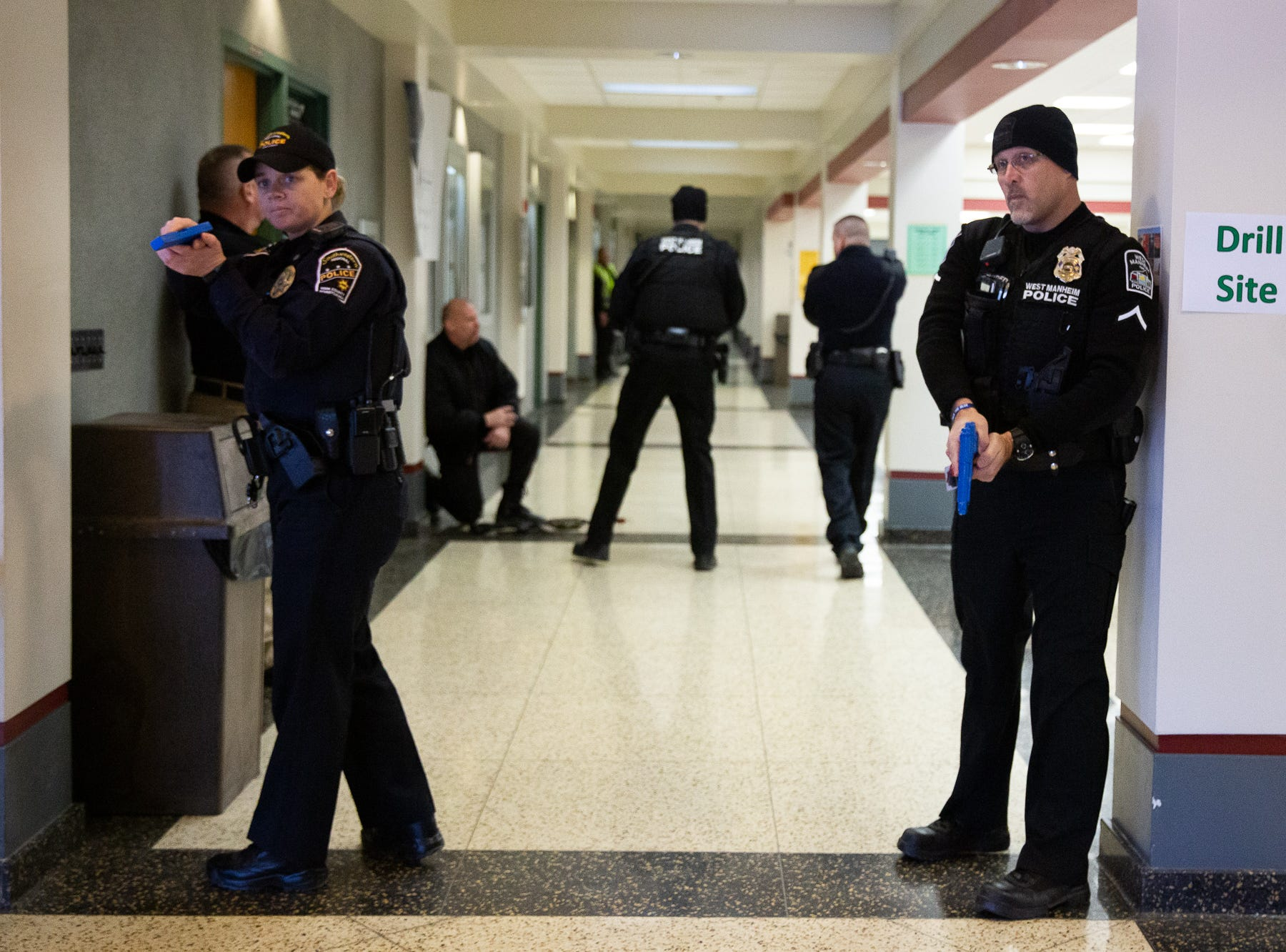 Police officers clear hallways while taking part in an active shooter drill at South Western High School, Monday, Jan. 21, 2019, in Penn Township. The drill simulated multiple scenarios involving an active shooter, allowing school security and local law enforcement agencies a hands-on opportunity to drill on engaging an active shooter while also giving school staff experience with how real world scenarios could unfold.