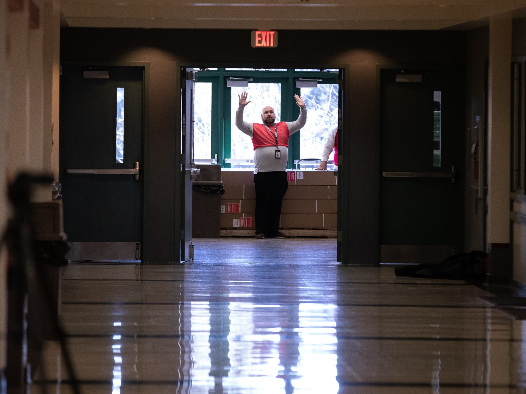 School staff raise their hands while they take part in an active shooter drill at South Western High School, Monday, Jan. 21, 2019, in Penn Township. The drill simulated multiple scenarios involving an active shooter, allowing school security and local law enforcement agencies a hands-on opportunity to drill on engaging an active shooter while also giving school staff experience with how real world scenarios could unfold.