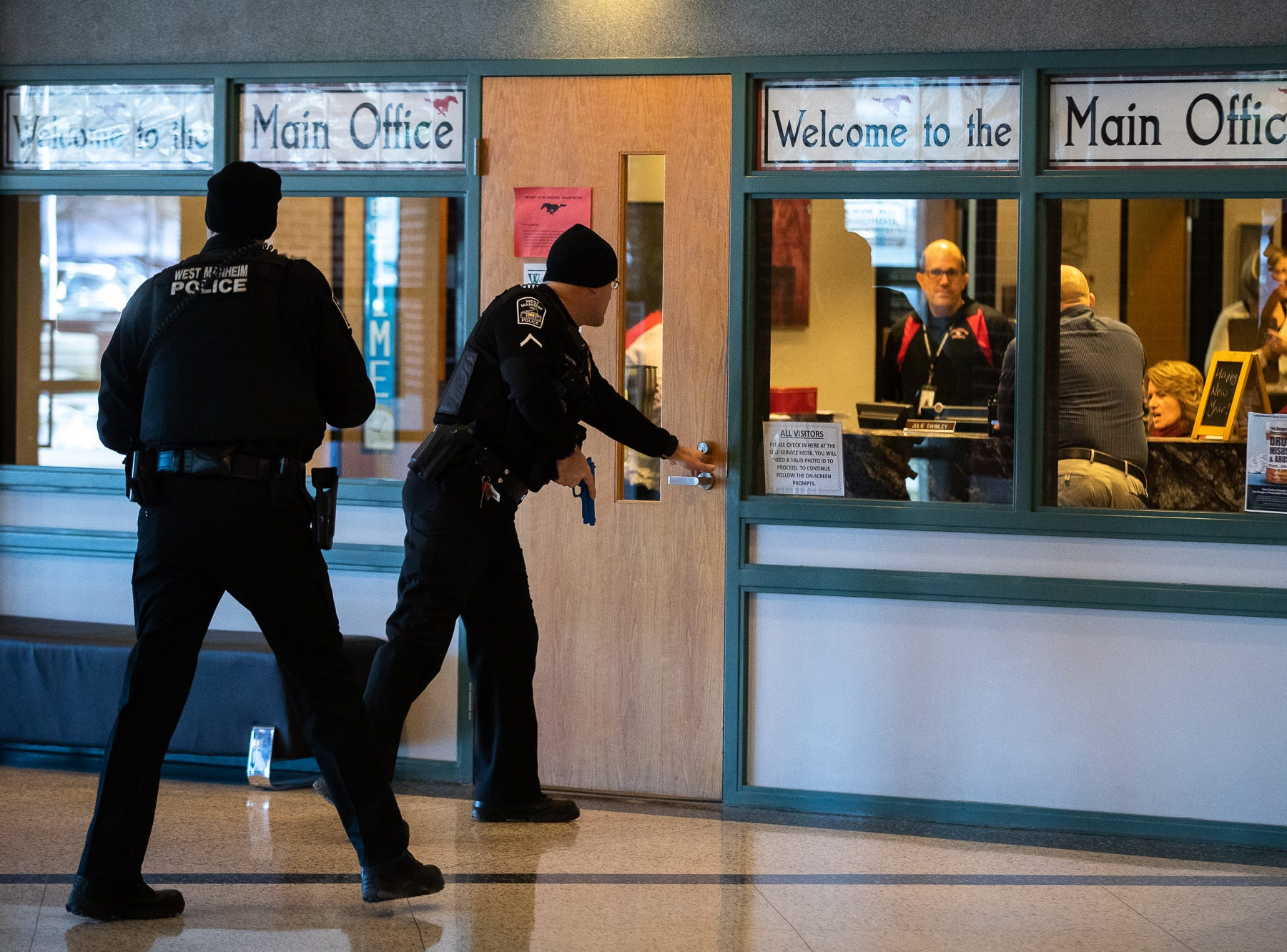 Police officers make entry while they take part in an active shooter drill at South Western High School, Monday, Jan. 21, 2019, in Penn Township. The drill simulated multiple scenarios involving an active shooter, allowing school security and local law enforcement agencies a hands-on opportunity to drill on engaging an active shooter while also giving school staff experience with how real world scenarios could unfold.