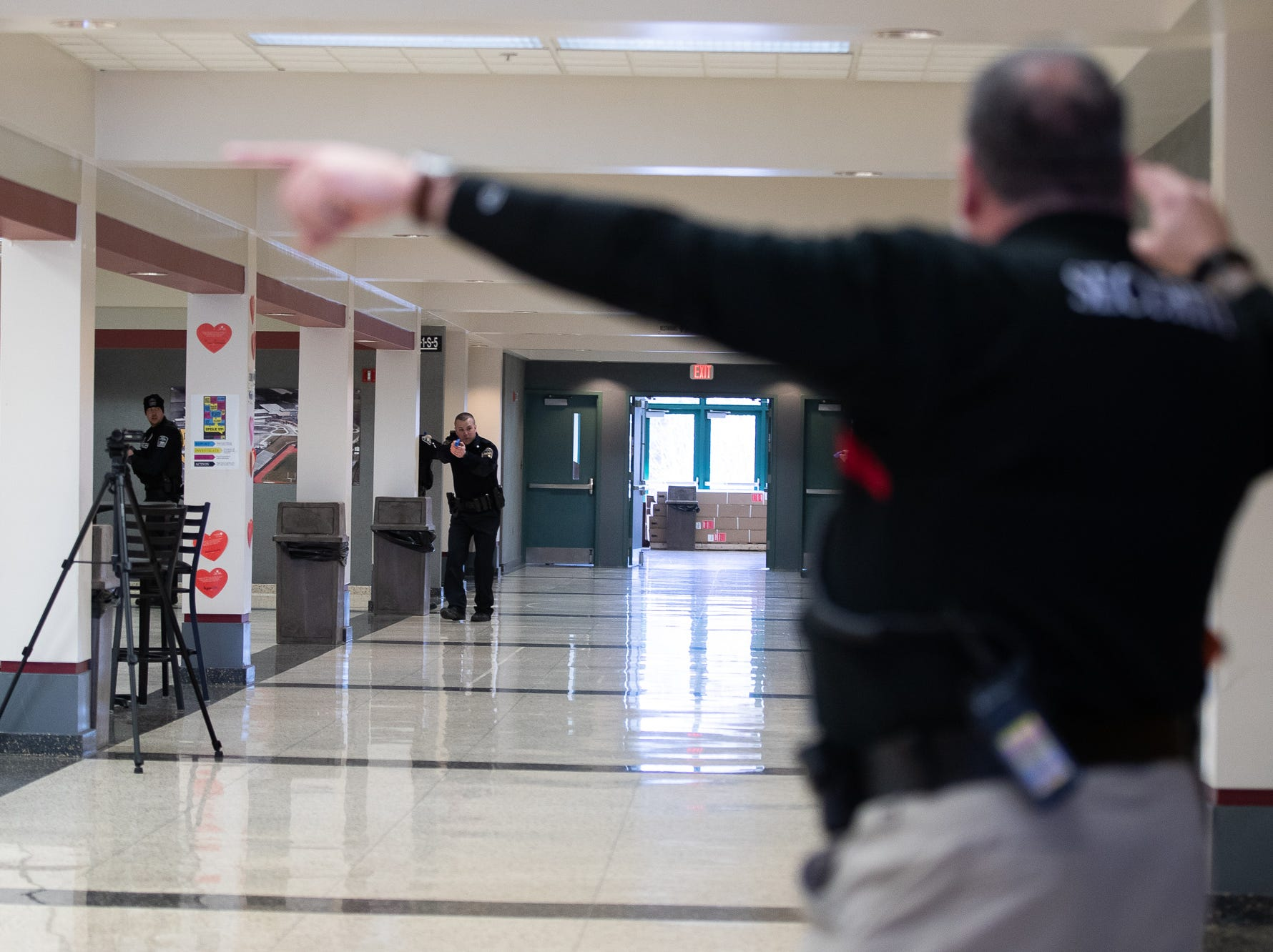 Police officers are directed by a school security guard to a downed shooter while taking part in an active shooter drill at South Western High School, Monday, Jan. 21, 2019, in Penn Township. The drill simulated multiple scenarios involving an active shooter, allowing school security and local law enforcement agencies a hands-on opportunity to drill on engaging an active shooter while also giving school staff experience with how real world scenarios could unfold.