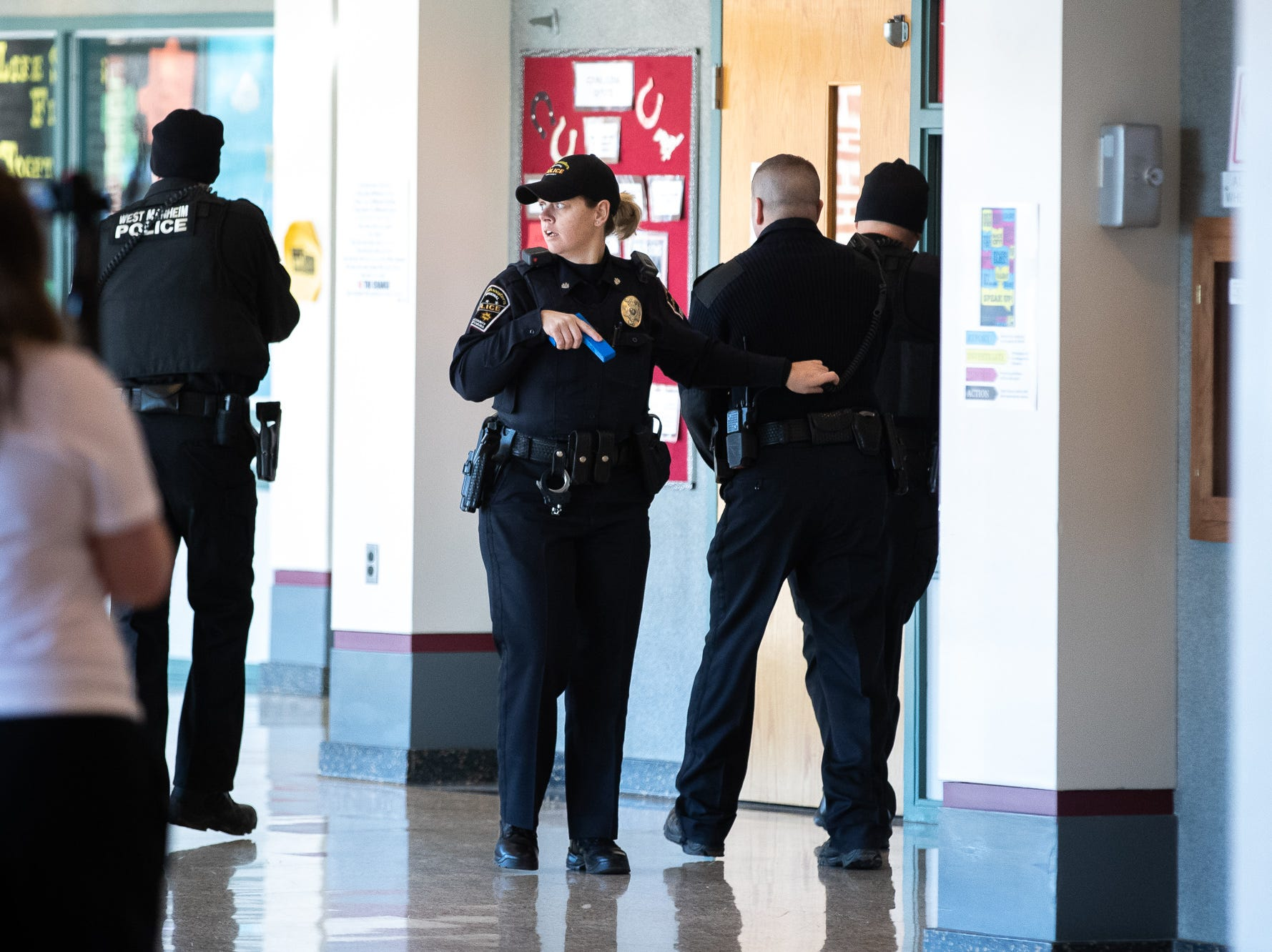 Police officers clear hallways while they take part in an active shooter drill at South Western High School, Monday, Jan. 21, 2019, in Penn Township. The drill simulated multiple scenarios involving an active shooter, allowing school security and local law enforcement agencies a hands-on opportunity to drill on engaging an active shooter while also giving school staff experience with how real world scenarios could unfold.