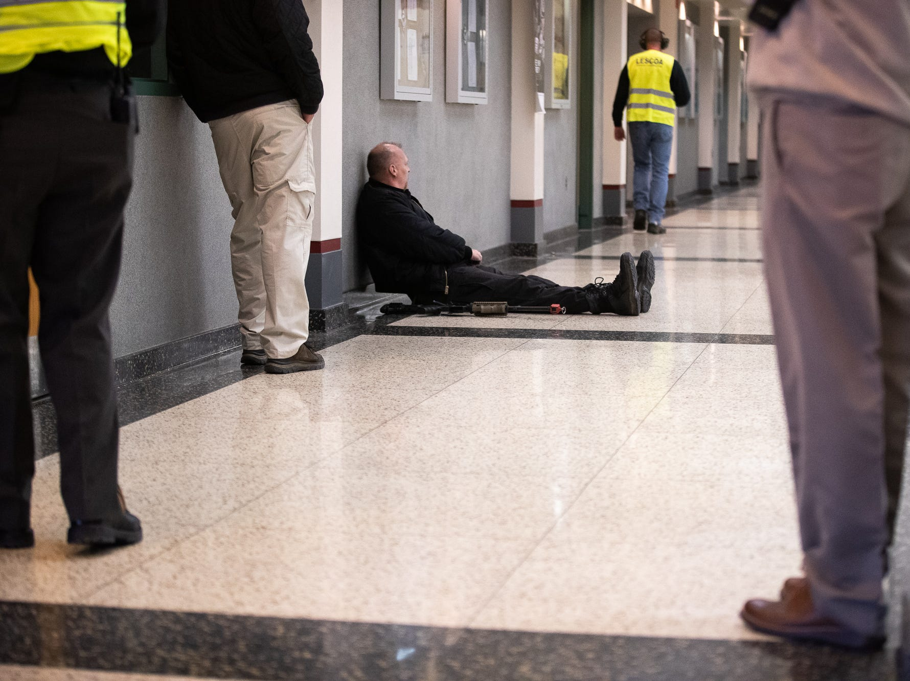 A man portraying an active shooter sits down after being taken out during an active shooter drill at South Western High School, Monday, Jan. 21, 2019, in Penn Township. The drill simulated multiple scenarios involving an active shooter, allowing school security and local law enforcement agencies a hands-on opportunity to drill on engaging an active shooter while also giving school staff experience with how real world scenarios could unfold.
