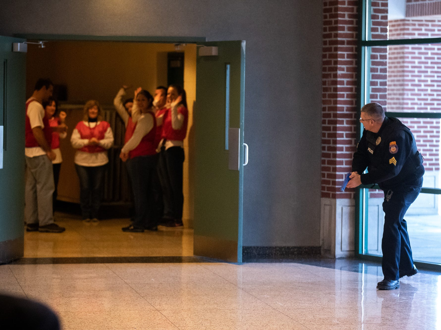 A Penn Township police officer makes contact with school staff during an active shooter drill at South Western High School, Monday, Jan. 21, 2019, in Penn Township. The drill simulated multiple scenarios involving an active shooter, allowing school security and local law enforcement agencies a hands-on opportunity to drill on engaging an active shooter while also giving school staff experience with how real world scenarios could unfold.