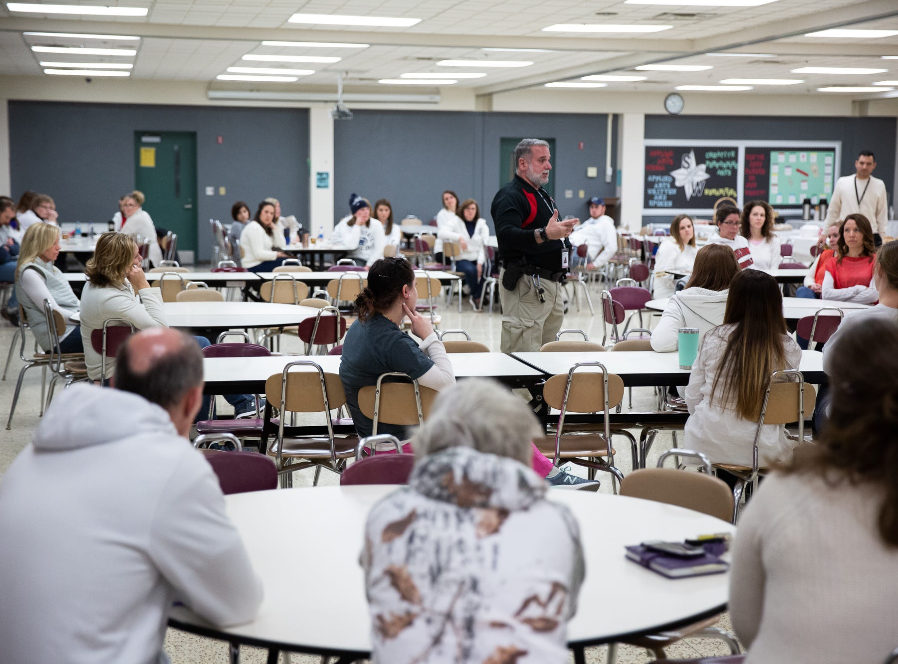 School staff debrief about lessons learned while they take part in an active shooter drill at South Western High School, Monday, Jan. 21, 2019, in Penn Township. The drill simulated multiple scenarios involving an active shooter, allowing school security and local law enforcement agencies a hands-on opportunity to drill on engaging an active shooter while also giving school staff experience with how real world scenarios could unfold.