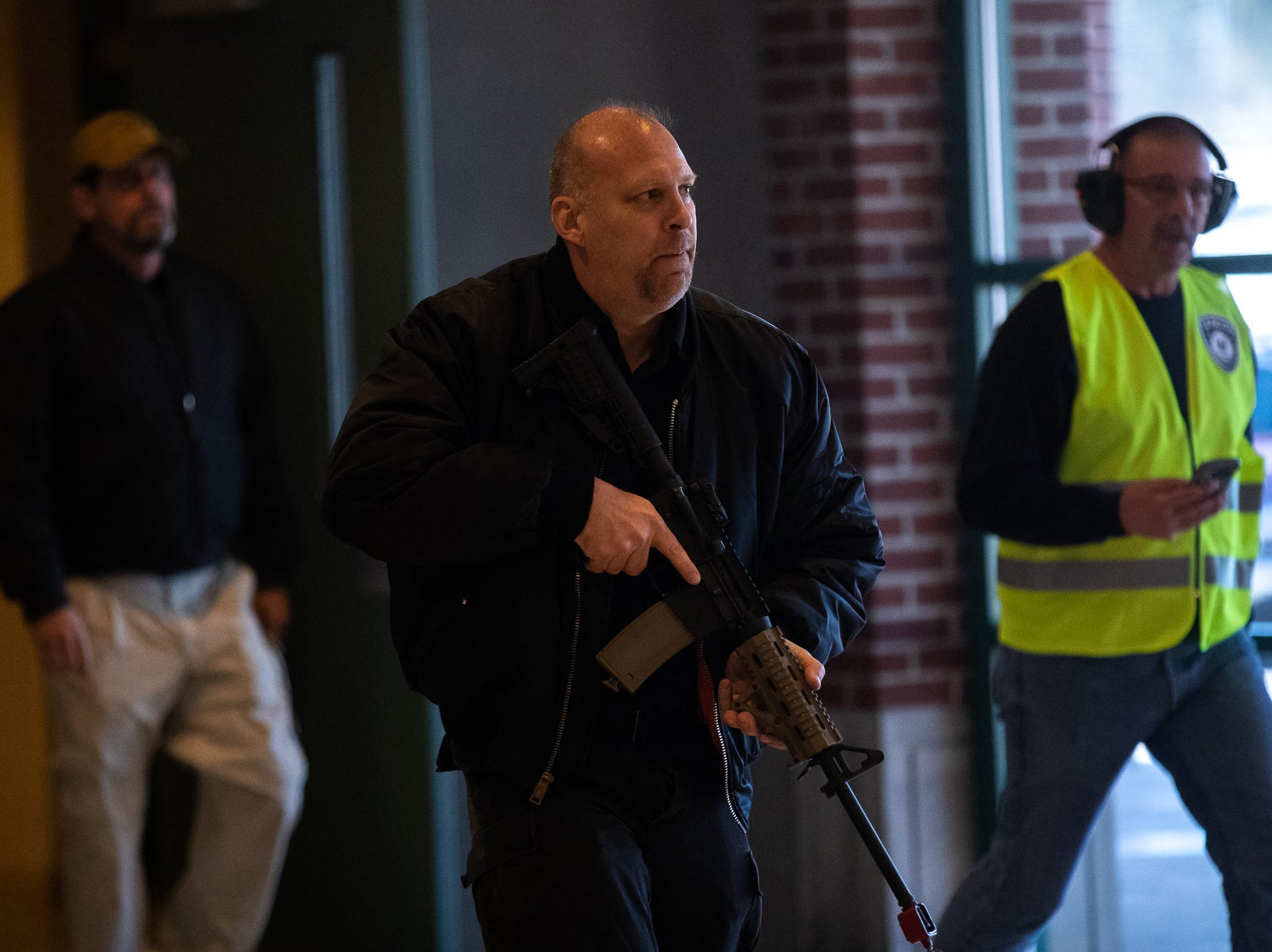 A man portrays an active shooter while taking part in an active shooter drill at South Western High School, Monday, Jan. 21, 2019, in Penn Township. The drill simulated multiple scenarios involving an active shooter, allowing school security and local law enforcement agencies a hands-on opportunity to drill on engaging an active shooter while also giving school staff experience with how real world scenarios could unfold.