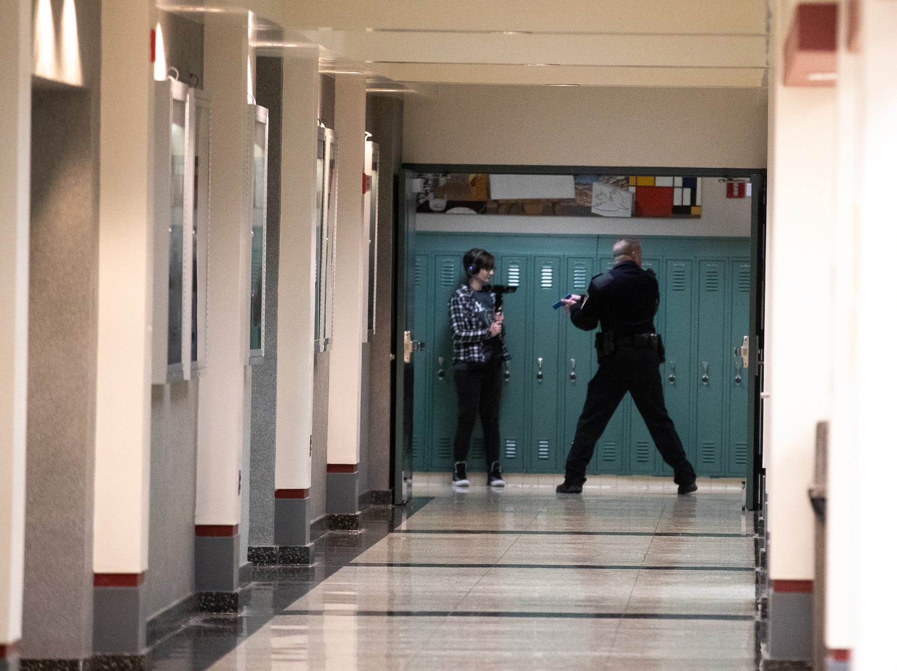 Police officers clear hallways during an active shooter drill at South Western High School, Monday, Jan. 21, 2019, in Penn Township. The drill simulated multiple scenarios involving an active shooter, allowing school security and local law enforcement agencies a hands-on opportunity to drill on engaging an active shooter while also giving school staff experience with how real world scenarios could unfold.