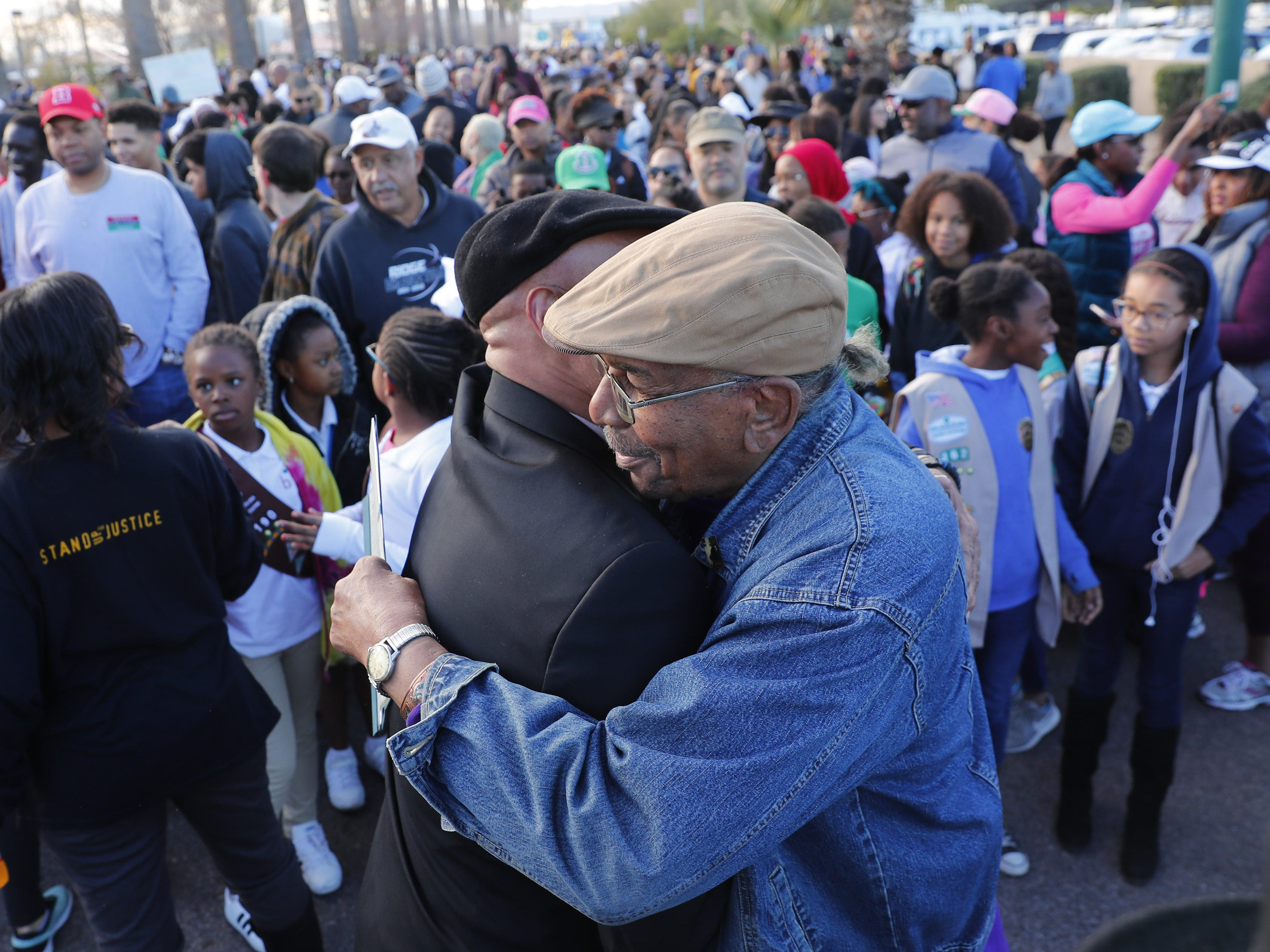 Rev. Gerald Richard II (left) greets Gene Blue before a march honoring Dr. Martin Luther King in downtown Phoenix, Ariz. January 21, 2019. The march is symbolic of Dr. King's revolutionary 1968 march.