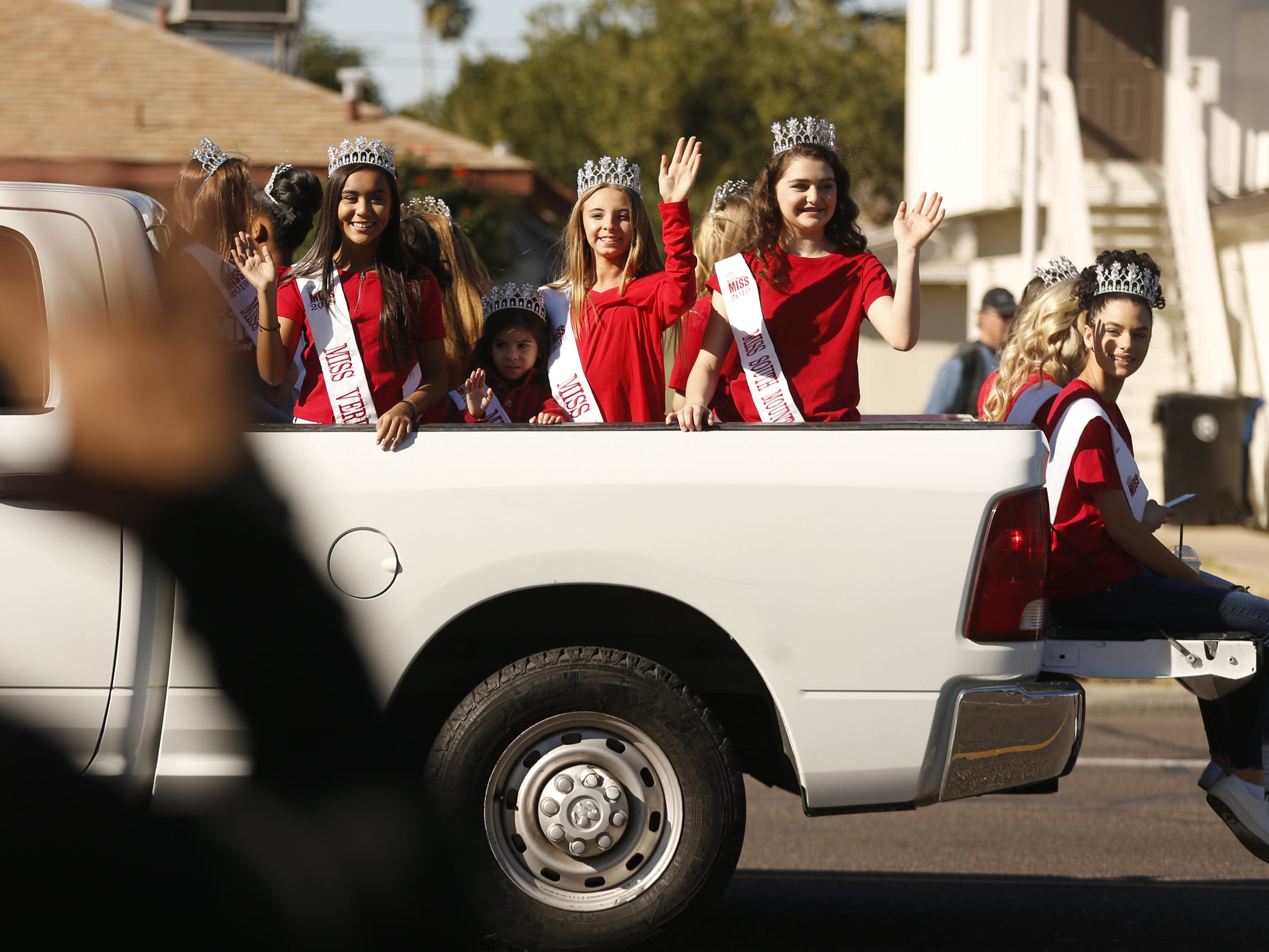 Miss Arizonas ride in the back of a truck on their way down the street during the MLK Day Parade in Mesa, Ariz. on January 21, 2019.