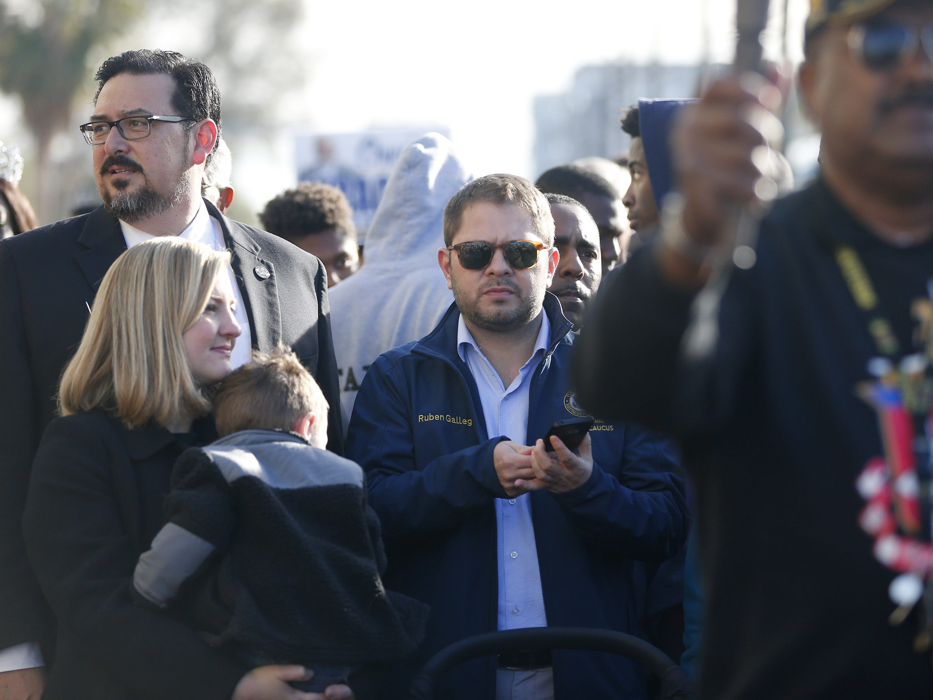 Maricopa County Recorder Adrian Fontes (left), Phoenix City Councilwoman Kate Gallego (center) and U.S. Rep Ruben Gallego (D-Ariz) march with others honoring Dr. Martin Luther King in downtown Phoenix, Ariz. January 21, 2019. The march is symbolic of Dr. King's revolutionary 1968 march.