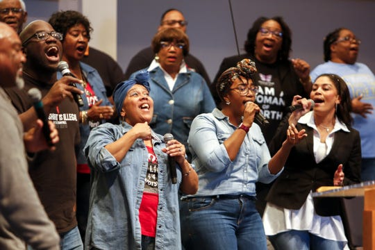 Members of the praise team, (from left to right) Vern Brackeen, Susan Rayford, Carmen Bradford and Tanisha Downing, sing together at the First Institutional Baptist Church on Sunday, Jan. 20, 2019.