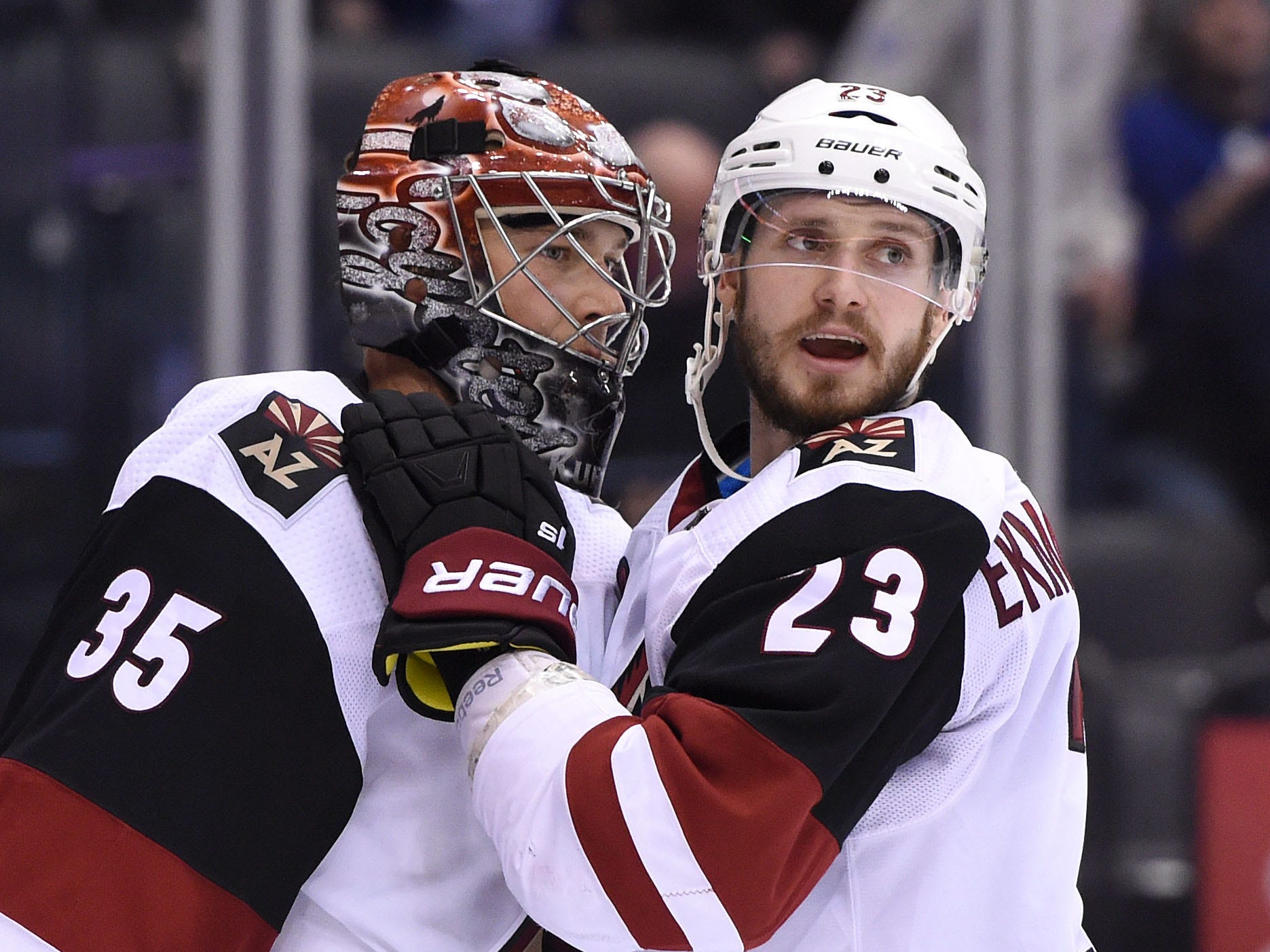 Jan 20, 2019; Toronto, Ontario, CAN;  Arizona Coyotes goalie Darcy Kuemper (35) is greeted by defenceman Oliver Ekman-Larsson (23) after a win over Toronto Maple Leafs at Scotiabank Arena. Mandatory Credit: Dan Hamilton-USA TODAY Sports