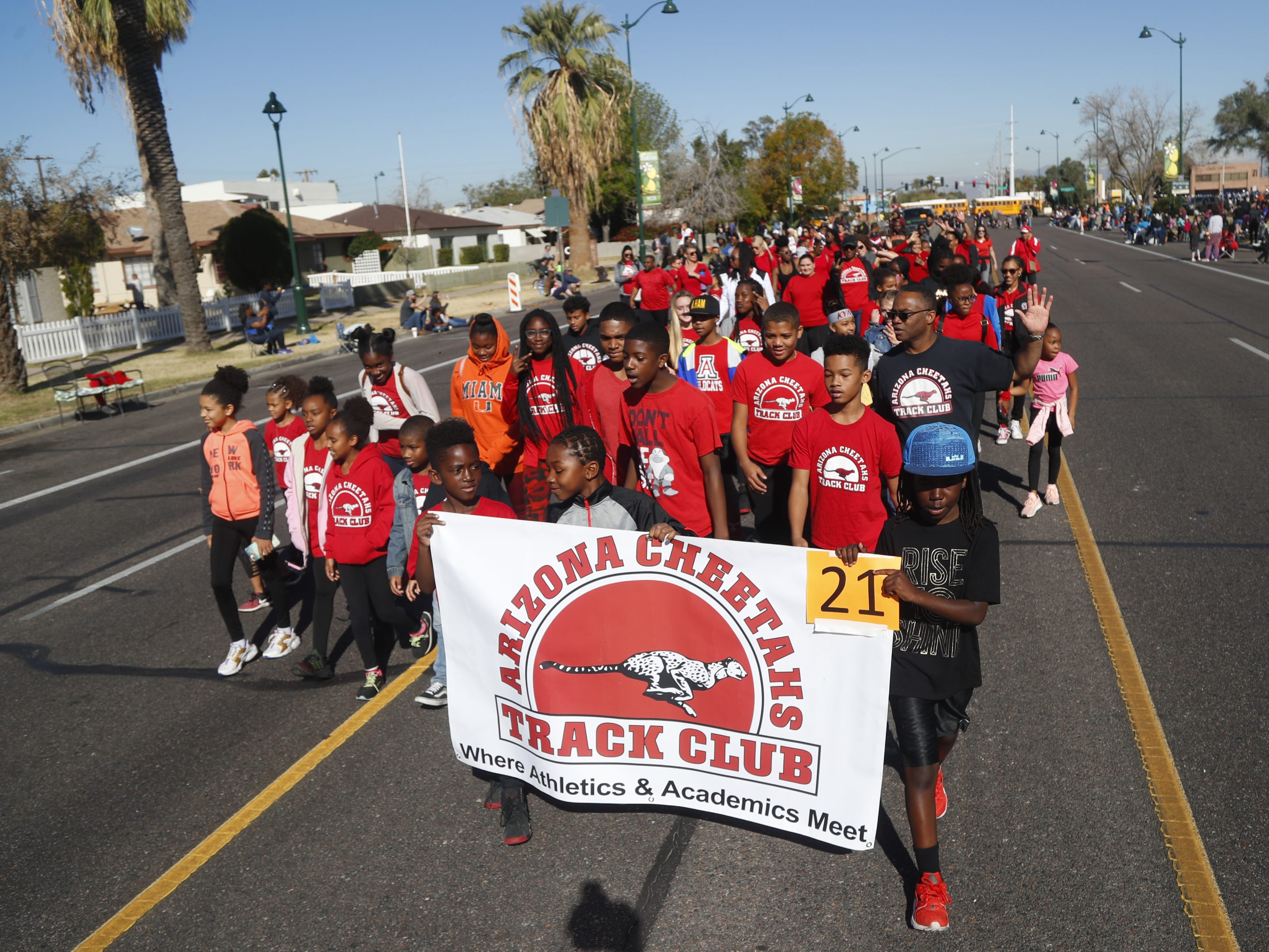 Arizona Cheetas Track Club carries its banner during the MLK Day Parade in Mesa, Ariz. on January 21, 2019.