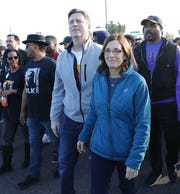 U.S. Rep. Greg Stanton (D-Ariz) and Sen. Martha McSally (R-Ariz) join a march honoring Dr. Martin Luther King in downtown Phoenix, Ariz. January 21, 2019. The march is symbolic of Dr. King's revolutionary 1968 march.