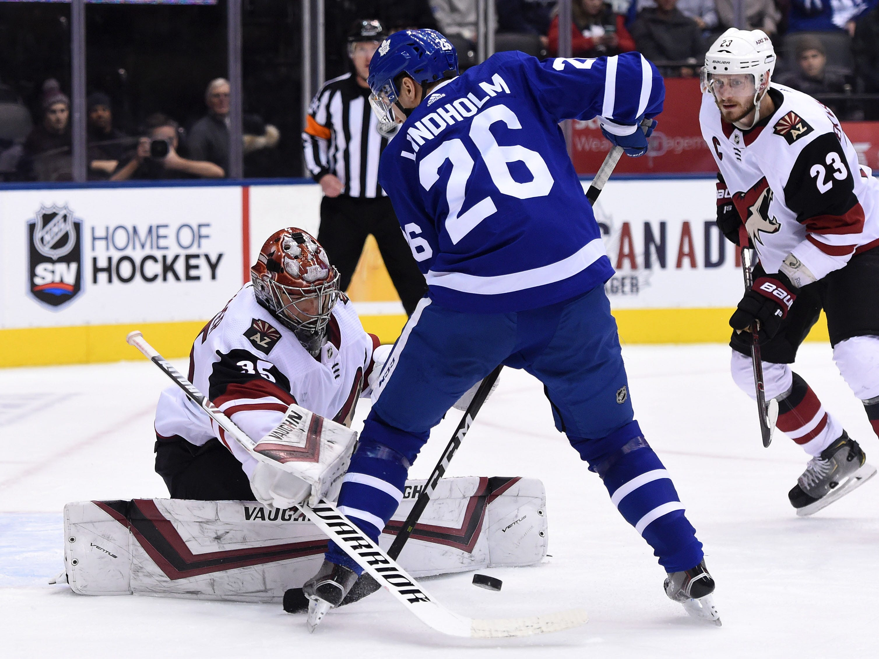 Jan 20, 2019; Toronto, Ontario, CAN;  Arizona Coyotes goalie Darcy Kuemper (35) makes a save in front of Toronto Maple Leafs forward Par Lindholm (26) in the third period at Scotiabank Arena. Mandatory Credit: Dan Hamilton-USA TODAY Sports