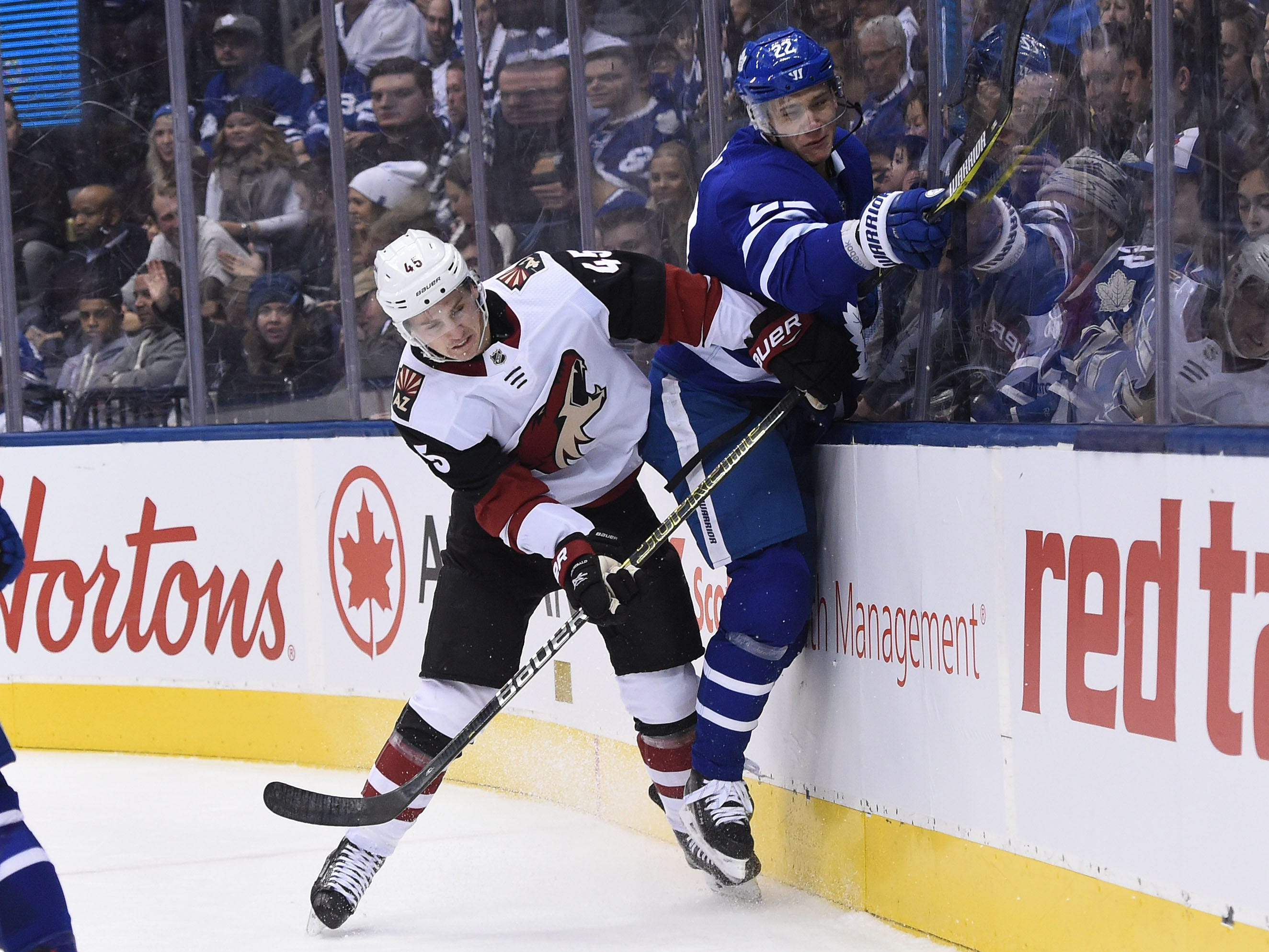 Jan 20, 2019: Arizona Coyotes forward Josh Arichibald (45) bodychecks Toronto Maple Leafs defenceman Nikita Zaitsev (22) in the first period at Scotiabank Arena.