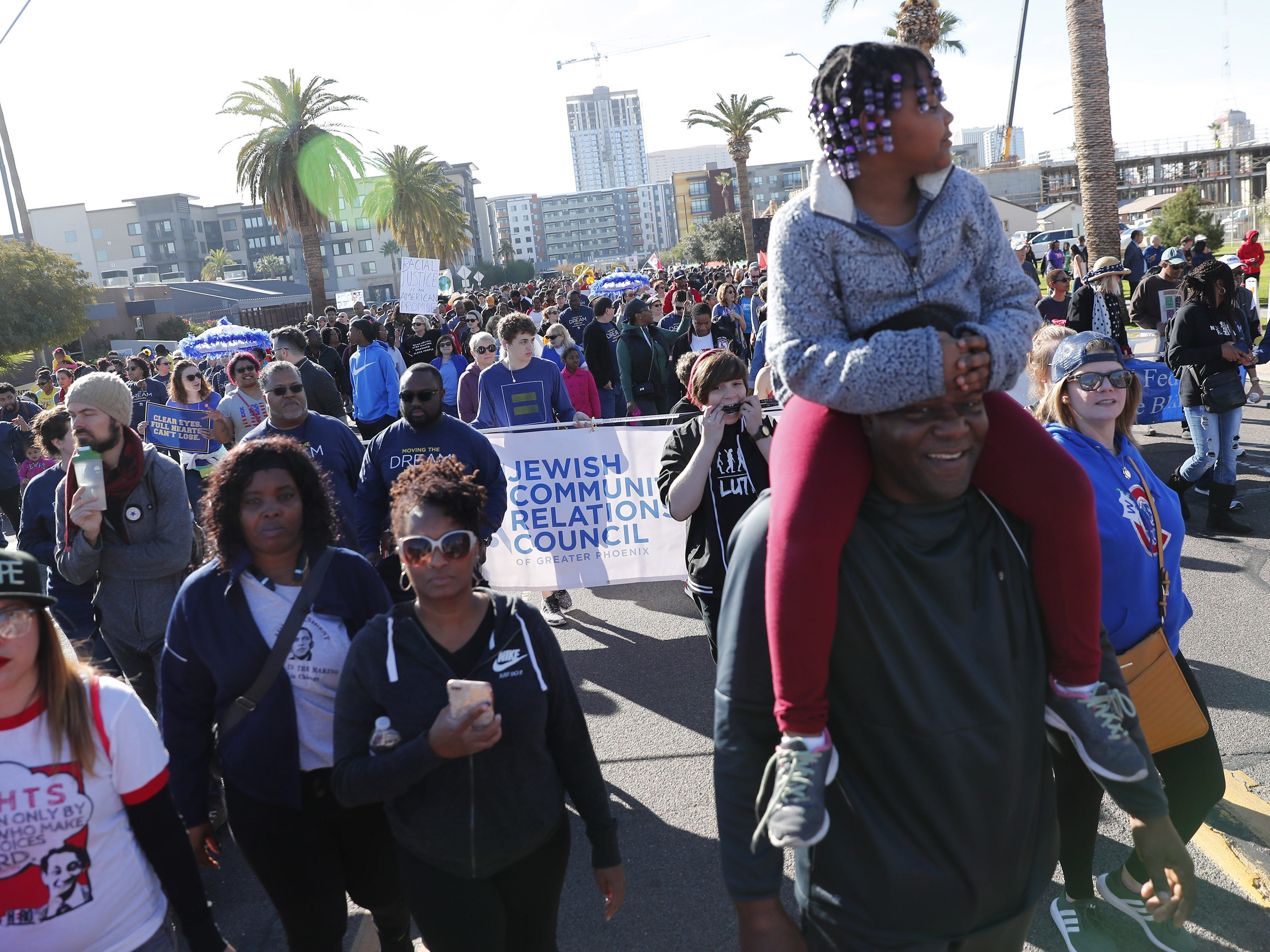 Thousands of people march honoring Dr. Martin Luther King in downtown Phoenix, Ariz. January 21, 2019. The march is symbolic of Dr. King's revolutionary 1968 march.