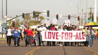 Hundreds of people march through Mesa during the MLK Day Parade on Monday, Jan. 21, 2018.