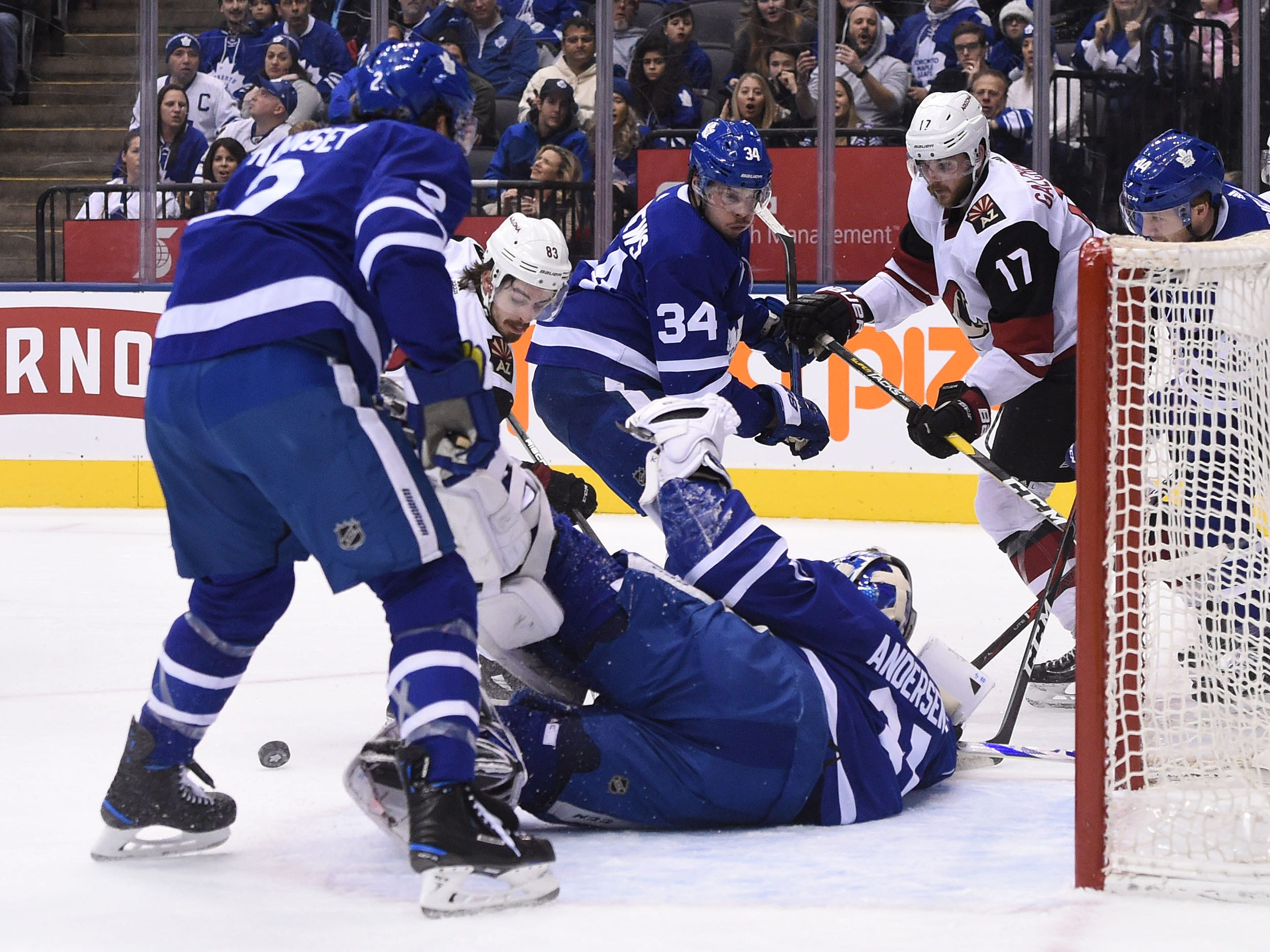 Jan 20, 2019: Toronto Maple Leafs goalie Frederik Andersen (31) makes a save against Arizona Coyotes forwards Alex Galyenchuk (17) and Conor Garland (83) in the first period at Scotiabank Arena.