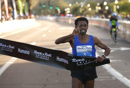 Daniel Mesfun (3) wins the Rock 'n' Roll half-marathon in Tempe on Sunday.