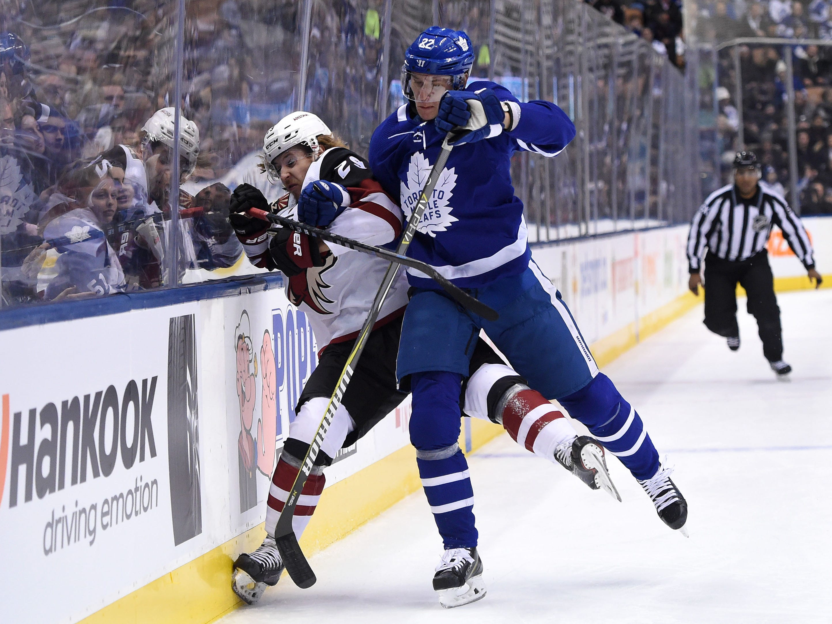 Jan 20, 2019: Toronto Maple Leafs defenceman Nikita Zaitsev (22) bodychecks Arizona Coyotes forward Mario Kempe (29) in the first period at Scotiabank Arena.