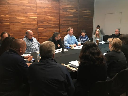 U.S. Representative Greg Stanton, D-Ariz., meets with federal workers and non-profits to discuss the impacts of the federal shutdown at Changing Hands Bookstore in Phoenix.