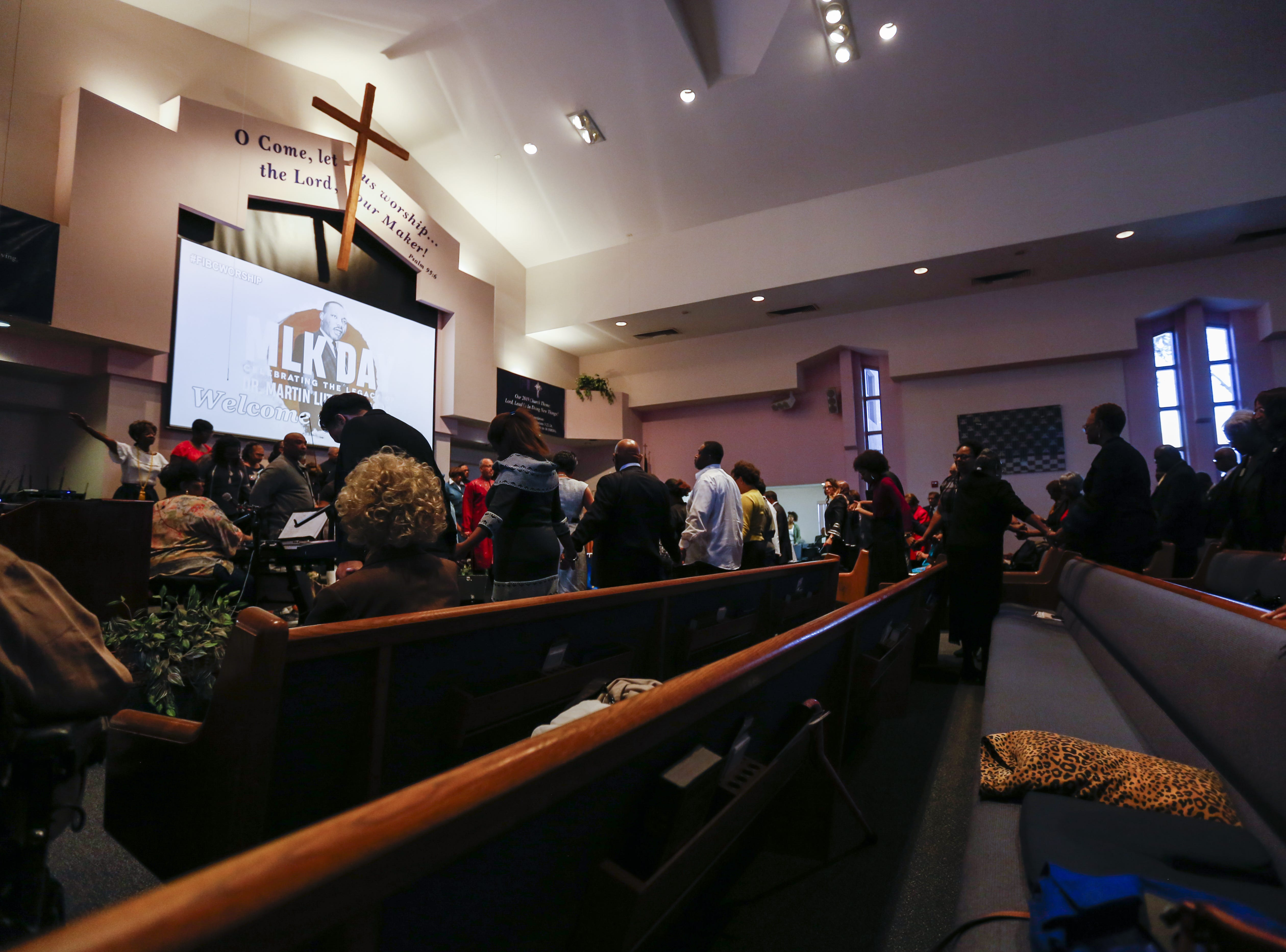 Congregation members bow their heads in prayer at First Institutional Baptist Church during services on Sunday, Jan. 20, 2019.