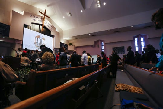 Congregation members bow their heads in prayer at First Institutional Baptist Church on Sunday, Jan. 20, 2019.