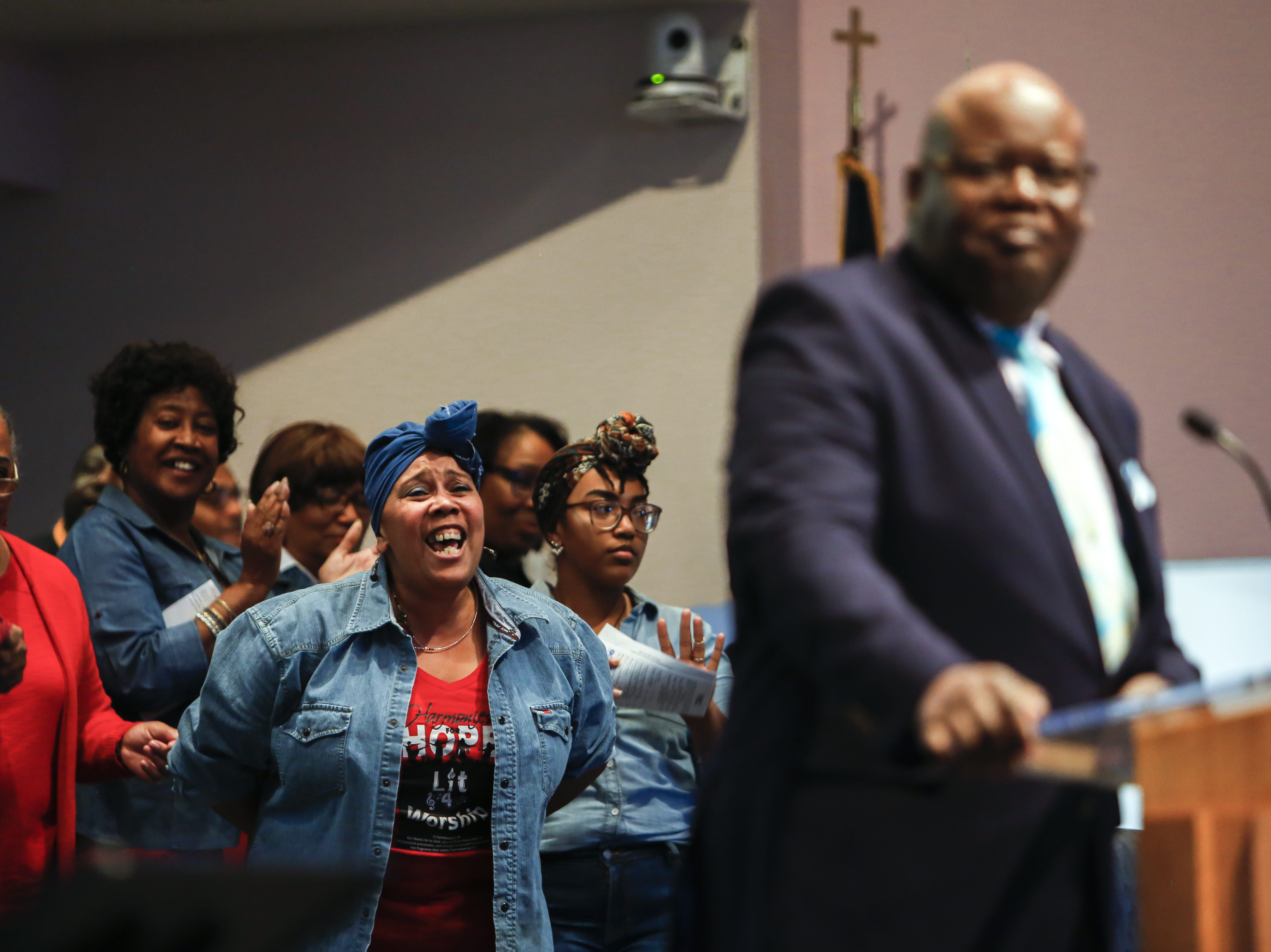 Praise team member Susan Rayford, left, calls out in song as Elder Jerome Ferrell begins his Scripture reading at First Institutional Baptist Church on Sunday, Jan. 20, 2019.