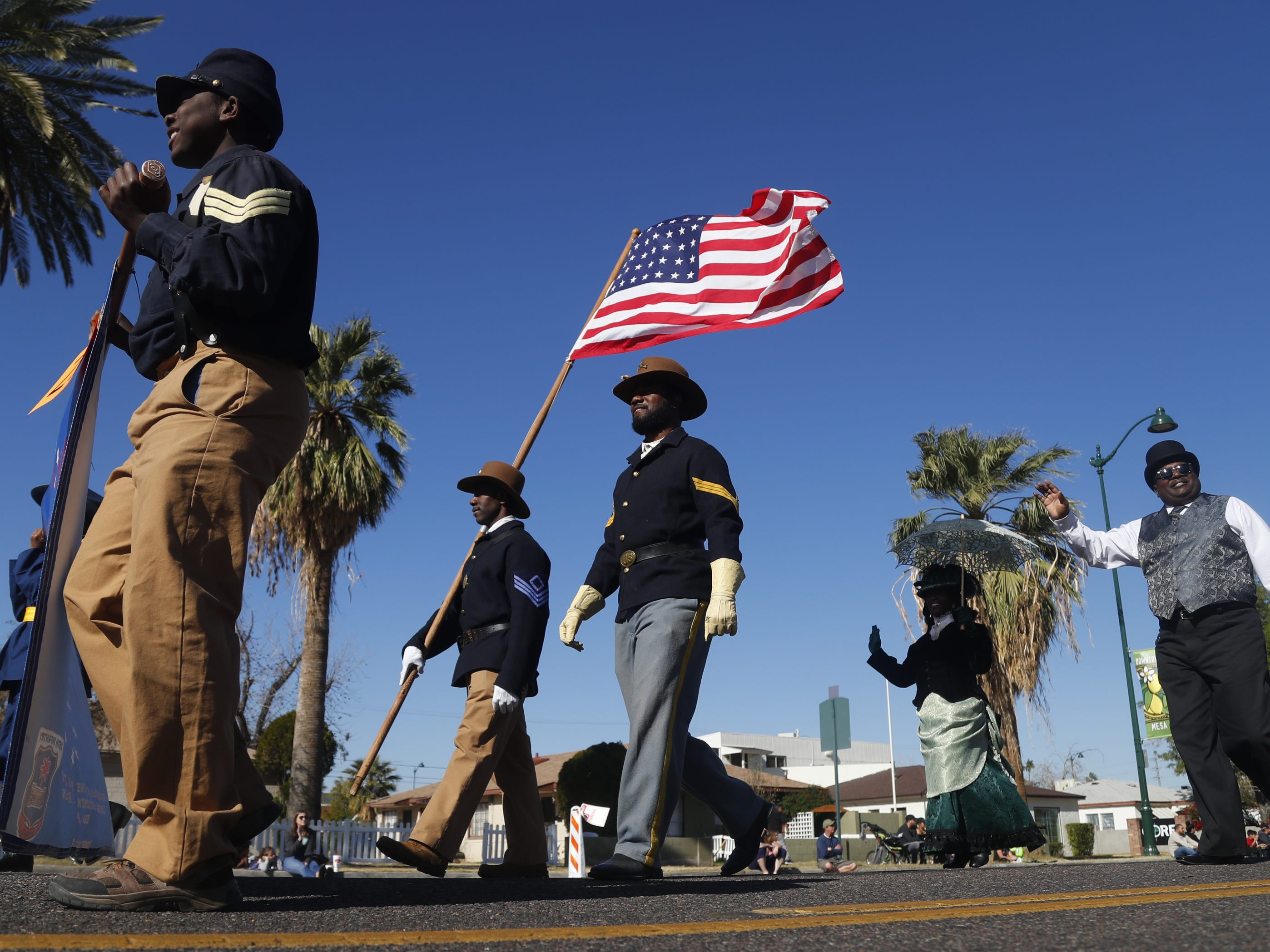 Buffalo Soldiers of Arizona come down the parade route during the MLK Day Parade in Mesa, Ariz. on January 21, 2019.