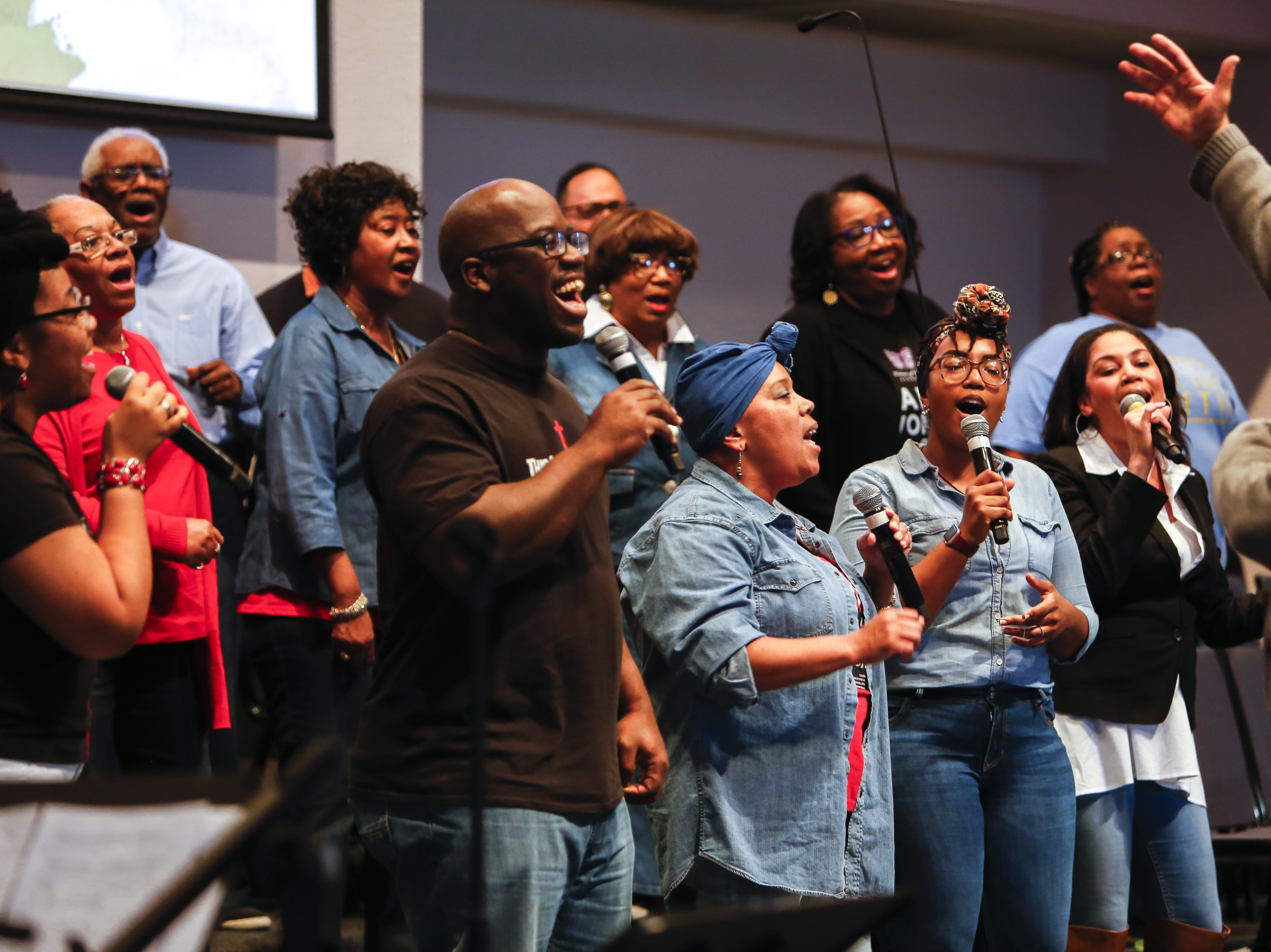 The praise team sings together, led by music director Kendall Washington, far right, at the First Institutional Baptist Church on Sunday, Jan. 20, 2019.