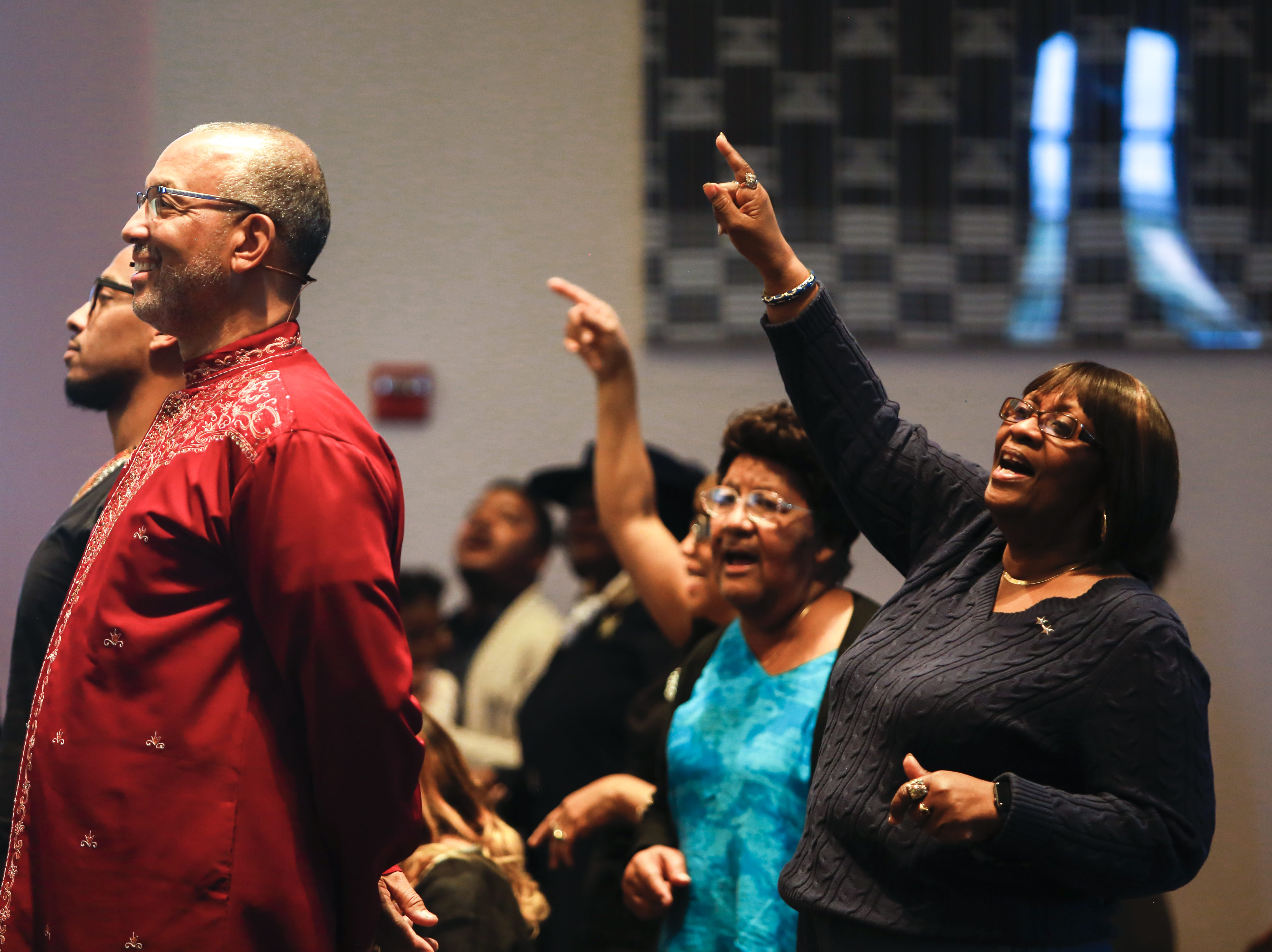 From right, Deloris Pickard, Anita Hopkins, Pastor Warren Stewart and his son Warren Stewart Jr. take part in the service at First Institutional Baptist Church on Sunday, Jan. 20, 2019.