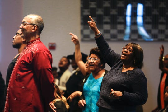 From right, Deloris Pickard, Anita Hopkins, Pastor Warren Stewart and his son Warren Stewart Jr. take part in a service at First Institutional Baptist Church on Sunday, Jan. 20, 2019.
