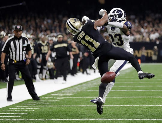 New Orleans Saints wide receiver Tommylee Lewis (11) works for a catch against Los Angeles Rams defensive back Nickell Robey-Coleman (23) during the second half of the NFC championship game Sunday. It clearly appeared that Robey-Coleman interfered with Lewis on the play, but no penalty was called. The no-call played a pivotal role in the Rams' 26-23. win.