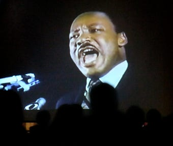 The Crispus Attucks 37th Annual MLK Day of Service celebrates King's legacy through song and prayer.