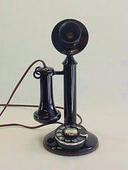 A candlestick telephone.