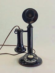 A candlestick telephone.
