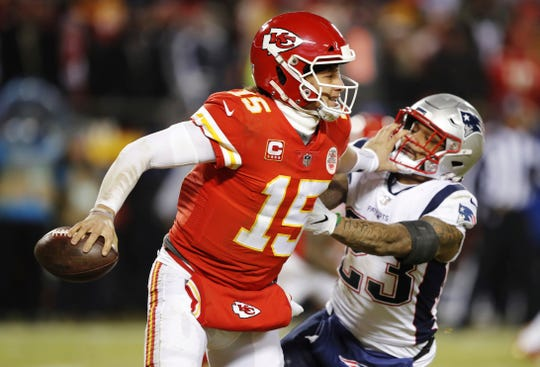 New England Patriots strong safety Patrick Chung (23) pressures Kansas City Chiefs quarterback Patrick Mahomes during the second half of the AFC Championship game. Mahomes never got chance with the ball in overtime.