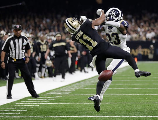 New Orleans Saints wide receiver Tommylee Lewis (11) was clearly hit before arrival of ball against Los Angeles Rams defensive back Nickell Robey-Coleman (23) during the second half of NFC title game. NFL will be forced to consider allowing coach's replay challenge for penalties and non-calls.