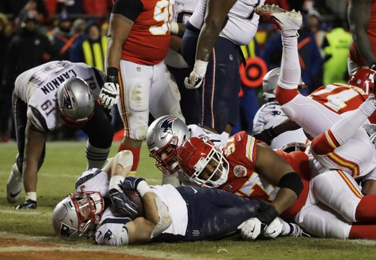 New England Patriots running back Rex Burkhead (34) dives to the end zone for a touchdown to win the AFC Championship NFL football game against the Kansas City Chiefs in overtime.