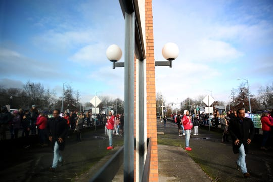 About 200 people participate in a Dr. Martin Luther King Jr. Day celebration and march from North Salem High School to the Oregon State Capitol in Salem on Monday, Jan. 21, 2019.