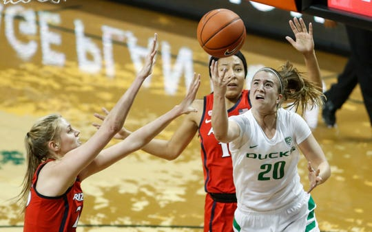 Oregon guard Sabrina Ionescu (20), shoots against Arizona defenders during an NCAA college basketball game Sunday, Jan. 20, 2019, in Eugene, Ore. Oregon beat Arizona 93-60.