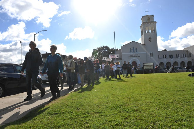 Marchers proceeded from the Salinas First United Methodist Church through Oldtown Salinas on Martin Luther King Jr. Day.
