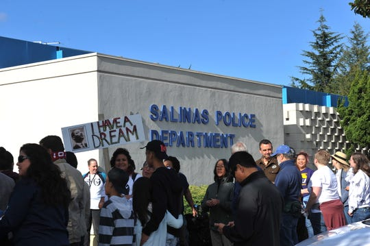 Marchers stop at the Salinas Police Department on their way through Oldtown Salinas on Martin Luther King Jr. Day.
