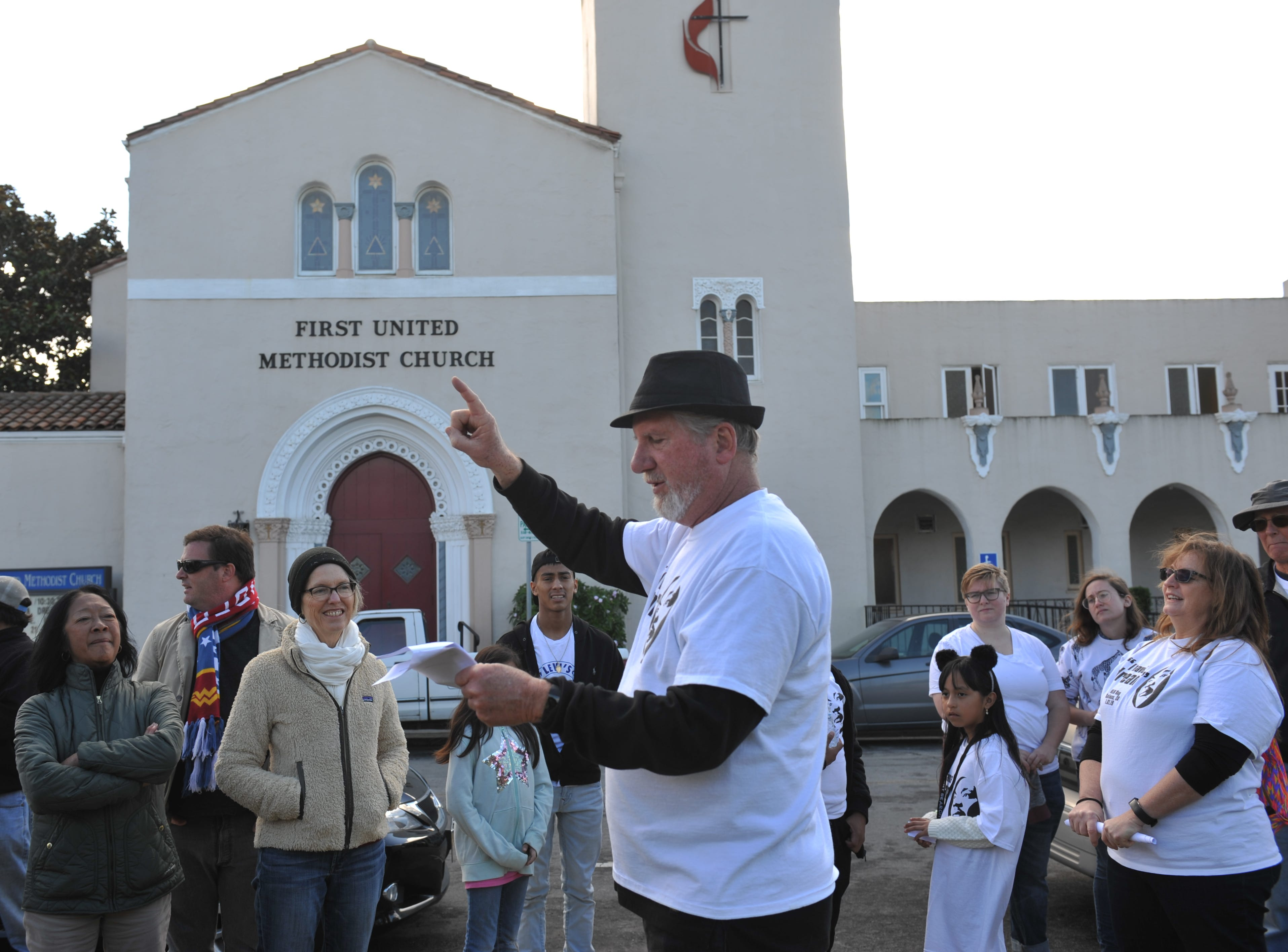 The Rev. Steve Lundin provides closing statements to end the march across from the Salinas First United Methodist Church.