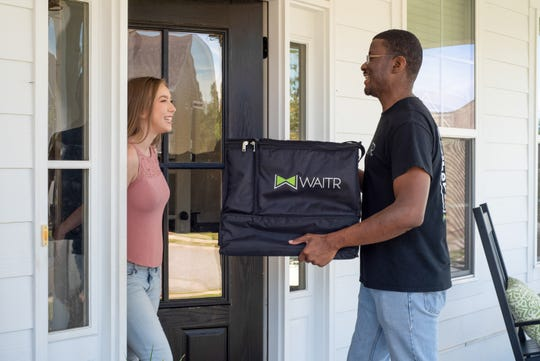 A promotional image from Waitr, a  food delivery app.